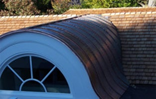 All Copper Standing Seam Half-Round Dormer Barrel Roof