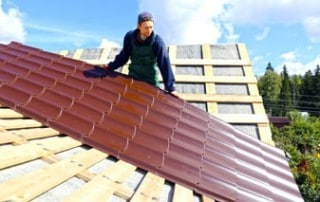 roofer installing metal roof