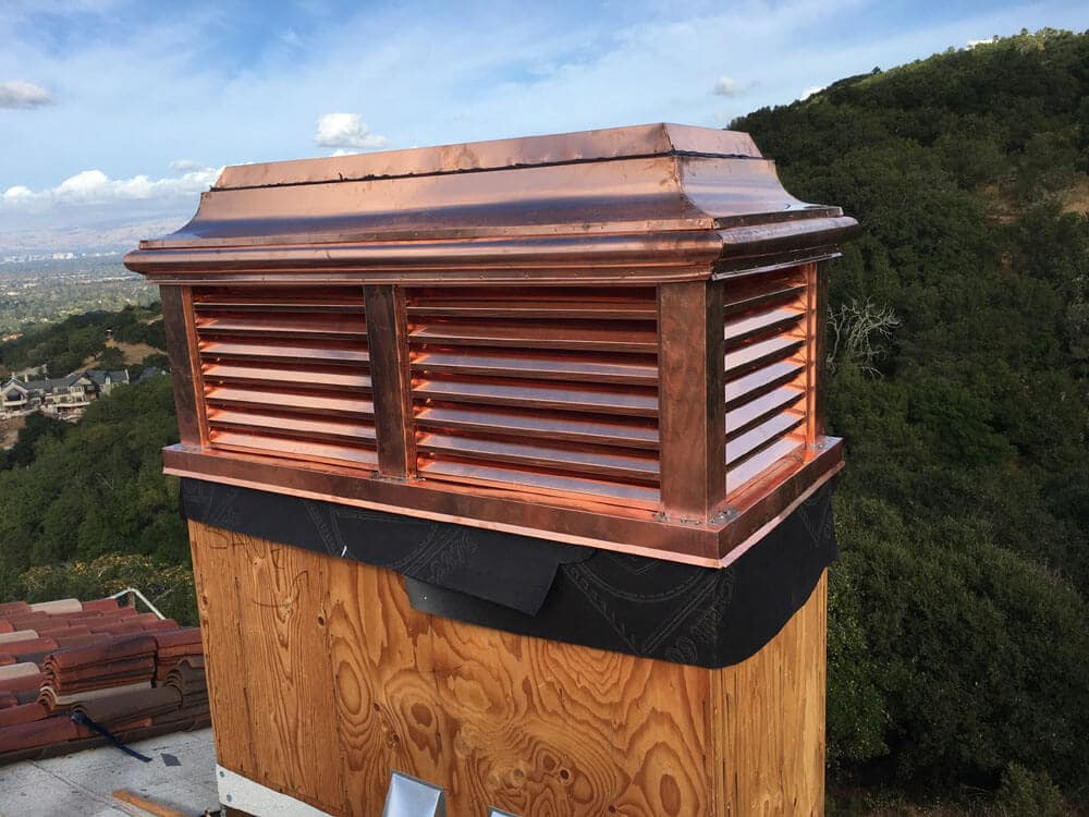 copper vented style chimney cap with view